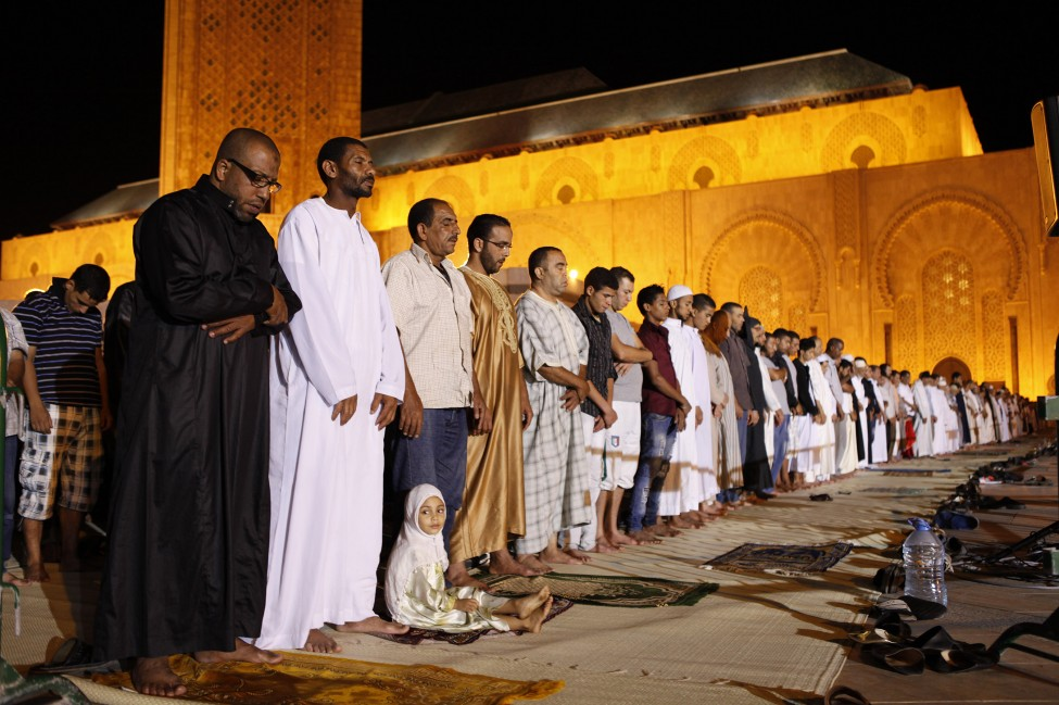 moroccans pray in the hassan II mosque